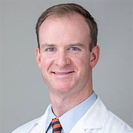 Headshot of Dr. Stranix wearing white labcoat