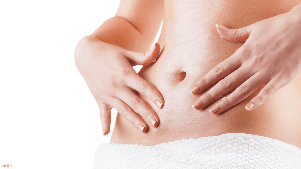 Woman worried about belly button before Tummy Tuck surgery in Charlottesville, VA.