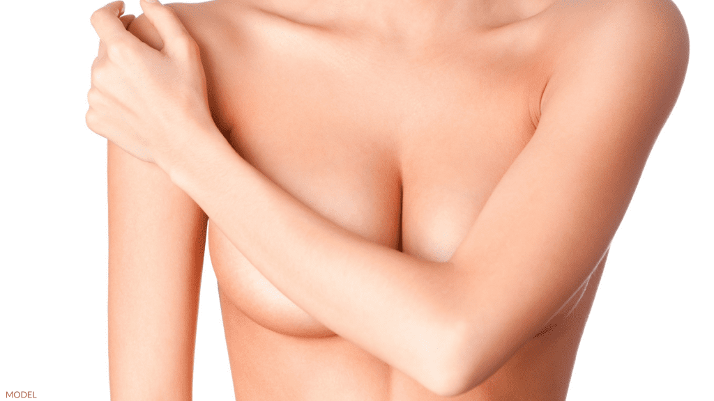 Woman thinking about replacing breast implants in Charlottesville, VA.